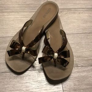 Brown Guess sandals with bronze bows size 9